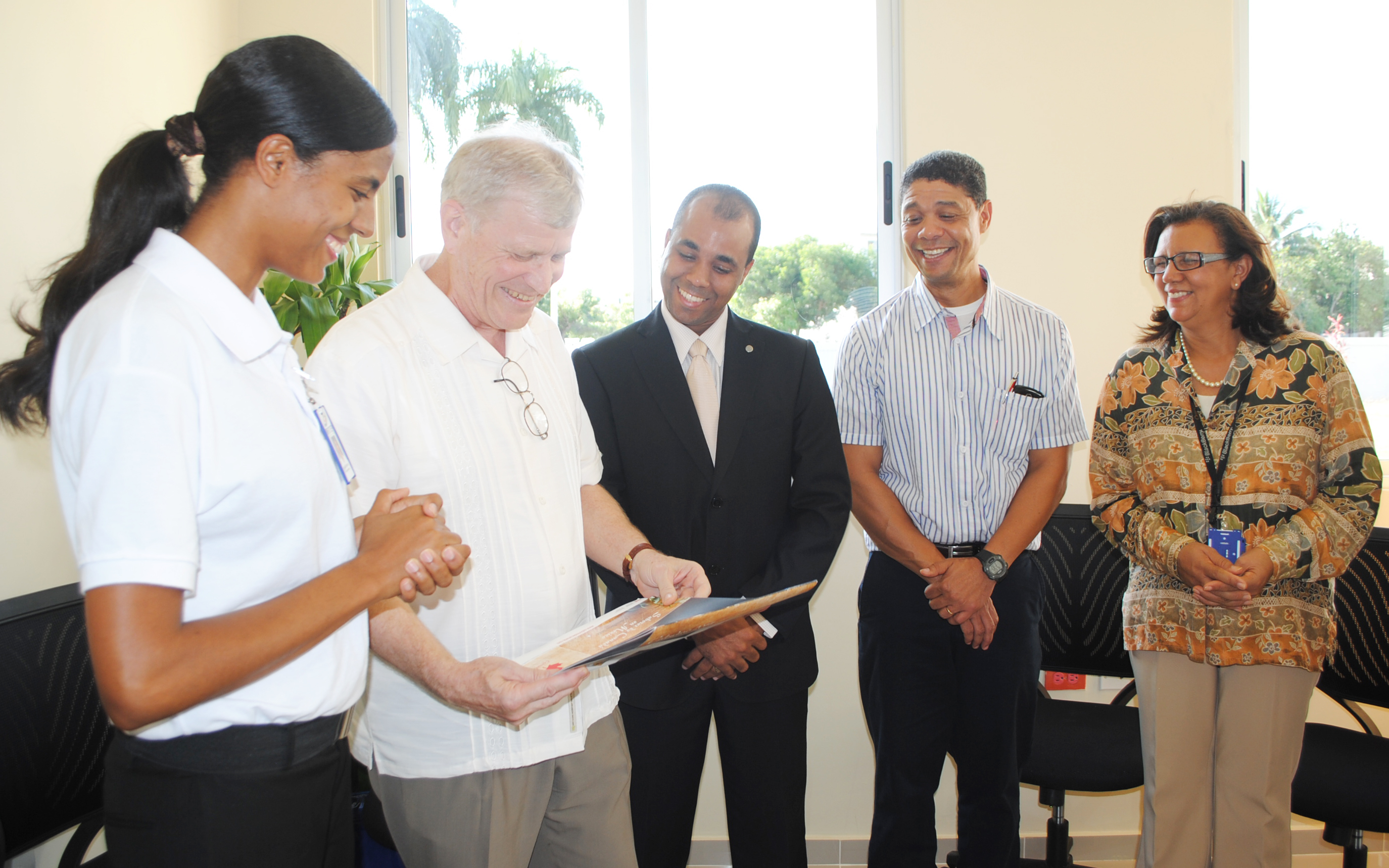 Managers of the Technical Institute Infotep in San Juan De La Maguana, showing the technical program to Canadian Ambassador Georges Boisse